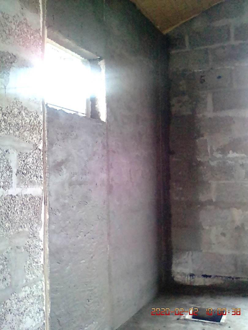 оштукатуренная поверхность стены